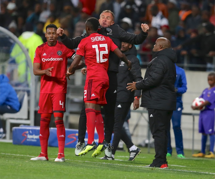Orlando Pirates head coach Mlutin Sredojevic chest bumps striker Justin Shonga in celebration during the Absa Premiership match against Chippa United at Nelson Mandela Bay Stadium on August 08, 2018 in Port Elizabeth, South Africa.