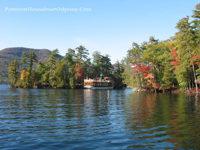 A beautiful wooden trawler cruising near the shoreline on a beautifully clear early fall day.