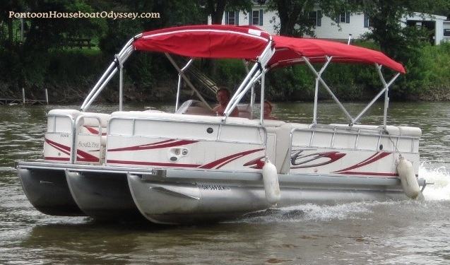 Southbay pontoon boat cruising along on the Muskingum River in Ohio.