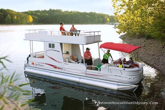 A Pontoon Boat With An Upper Deck Several Family Members Enjoying Quality Outdoor Time On