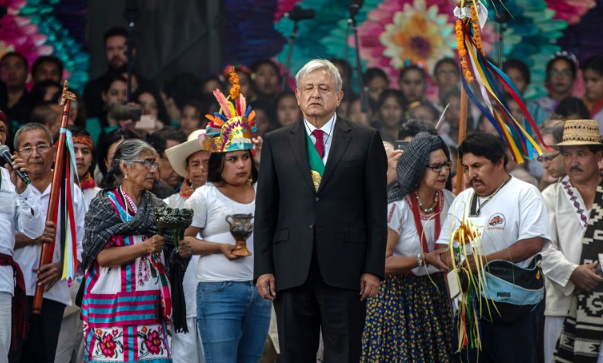 Mexican President Andres Manuel Lopez Obrador, centre, stands on stage during the 58th presidential inauguration event at the central plaza in Mexico City, Mexico, on Saturday, December 1 2018. Picture: ALEJANDRO CEGARRA/BLOOMBERG