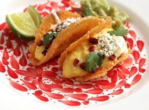 Cheesy Taco Shells Filled With Soft Scrambled Eggs.  You Fill With Whatever You Want!