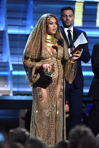 Beyonce Knowles accepts the Best Urban Contemporary Album award for 'Lemonade' onstage during The 59th GRAMMY Awards at STAPLES Center on February 12, 2017 in Los Angeles, California.  (Photo by Jeff Kravitz/FilmMagic)