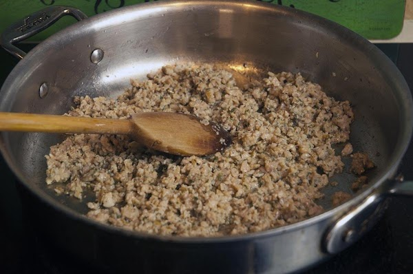 Cook the sausage; breaking it up into small pieces with a wooden spoon, as...