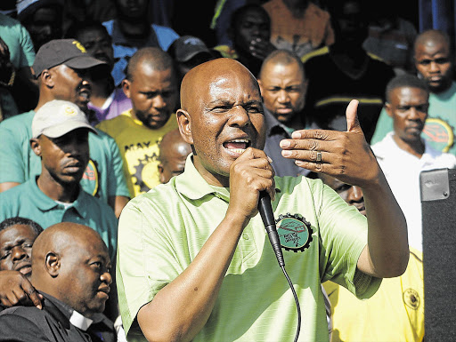 Amcu president Joseph Mathunjwa. His union has approached the labour court to force the department of mineral resources and energy to set minimum standards for health and safety during the Covid-19 pandemic.