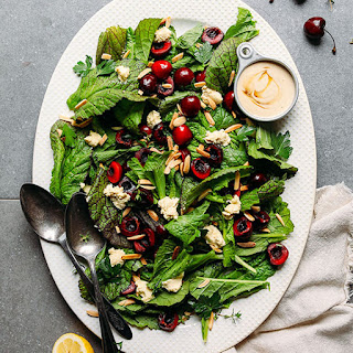 Mustard Green Cherry Salad with Nut Cheese & Tahini Dressing.