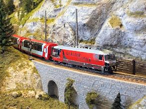 Photo: 012 The Glacier Tour express negotiates some rugged alpine terrain on the Bergellerbahn .
