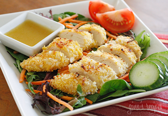 Warm oven-fried crispy coconut chicken strips over a bed of baby greens, cucumber, tomato, shredded carrots topped with a hot honey mustard vinaigrette. It's the perfect mix of salty and sweet, warm and cold.