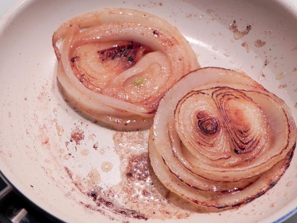 Saute your whole sliced onions in a pan with butter till soft.