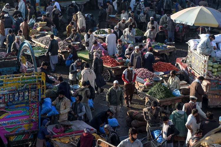 Traders and customers bargain over prices at a crowded vegetable market during a government-imposed nationwide lockdown to curb the spread of the Covid-19 coronavirus, in Peshawar, Pakistan.