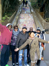 Photo: Hidden Garden Steps donor Utopia Hammond (arms extended, foreground, right-hand side of the photograph) with family members at the foot of the Steps (16th Avenue, between Kirkham and Lawton streets in San Francisco's Inner Sunset District) during the opening celebration (Saturday, December 7, 2013)  For more information about the Steps, please visit our website (http://hiddengardensteps.org), view links about the project from our Scoopit! site (http://www.scoop.it/t/hidden-garden-steps), or follow our social media presence on Twitter (https://twitter.com/GardenSteps), Facebook (https://www.facebook.com/pages/Hidden-Garden-Steps/288064457924739) and many others.