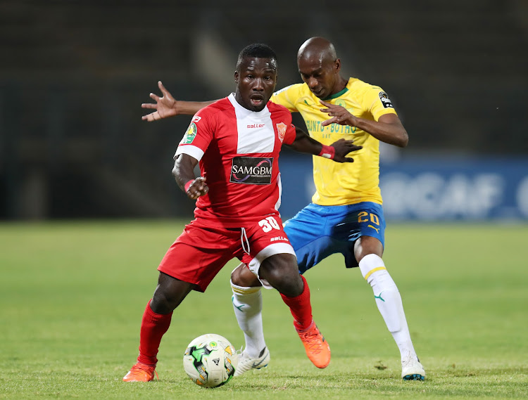 Mandela Ocansey of Horoya SC is challenged by Anele Ngcongca of Mamelodi Sundowns during the Caf Champions League match at the Lucas Moripe Stadium in Atteridgeville, west of Pretoria, on August 28 2018.