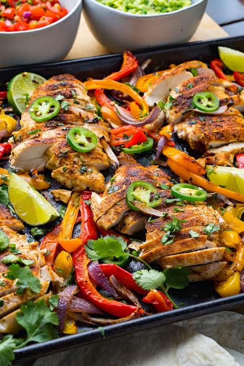 "Sheet Pan Chicken Fajita Nachos""Fajitas are one of my favourites and although..."