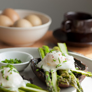 Eggs Benedict with Asparagus on Portobello Mushrooms with Goat Cheese Sauce.