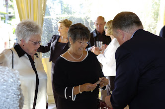 Photo: Betty Lou Stein Wilson, '58, and Toni Calamia Stevenson checking in with David Gilmour