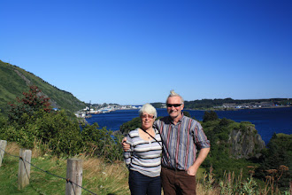 Photo: Bill and Lidia my British cruising friends I met in Dutch Harbor. Kodiak City in background