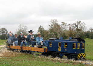 Photo: Marge Leventon's dad in the conductor's seat, holding his hands high.   HALS Run Day 2009-1121