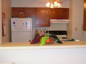 Photo: Galley kitchen with bar in 4-plex units