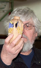 Photo: Ed Karch looks through his carved hollow form.