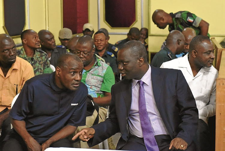 Former soldiers attend their trial in Abijan for the murder of Gen Robert Guei, assassinated in Cote dIvoire in 2002. Guei lost an election to Laurent Gbagbo (soon after leading a coup) two years before he was killed. Picture: GALLO IMAGES/AFP/ISSOUF SANOGO