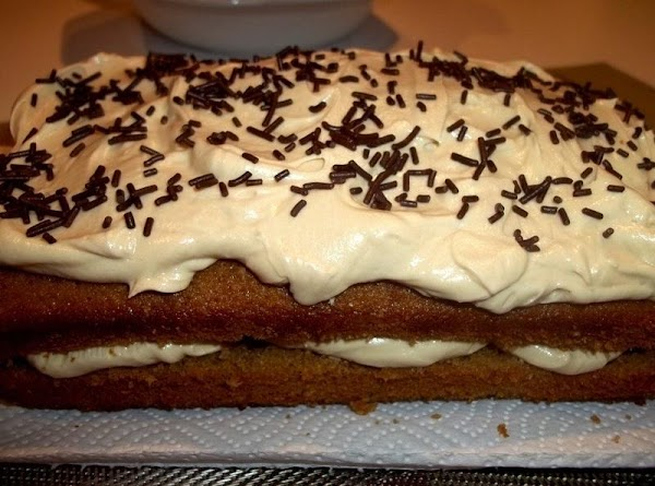 Spread remaining butter cream on top of the cake and sprinkle with chocolate sprinkles...