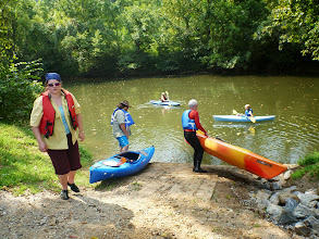 Photo: Stephanie in the river with Ivy. Dusty & Carl getting ready to put in. Nicole heading up to get her kayak.