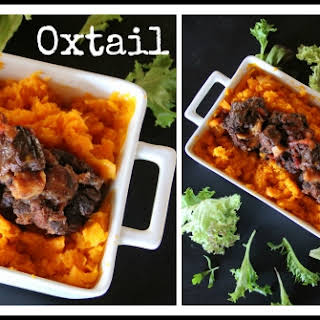 Slow-Cooked Oxtail in Red Wine & Tomatoes.