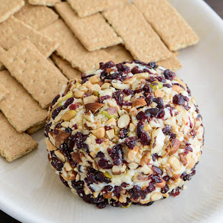 Dessert Cheese Ball with Cranberries and Mixed Nuts.