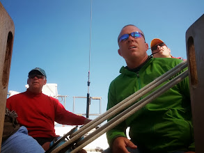 Photo: Bill at the helm during the race