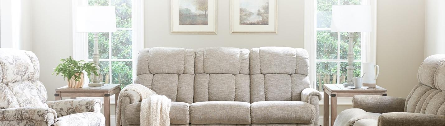 A picture containing sofa, living, indoor, windowDescription automatically generated