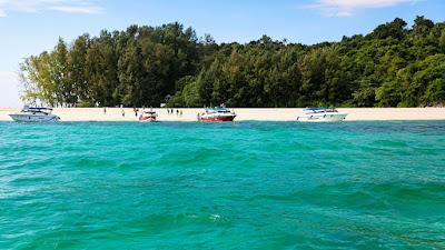 Swim at the white sand beach of Bamboo Island