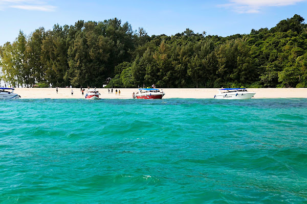 Swim at the white sand beach of Bamboo Island