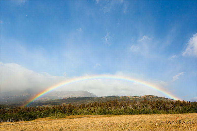 Photo: Rainbow Land - #Photographyworkflow, #howtophotograph  Our workshop in Glacier National Park was one of best trips we had this year...This was one of the few occasions when we had a rainbow during sunrise. And for next 5 hours there were rainbows behind every bend as we drove from St. Mary's to Two Medicine Lake. Here is a shot from side of the road that show a near perfect full rainbow.  How was this Image created?  The composition and exposure for the image was pretty simple as the sun was almost directly behind us and everything was pretty evenly lit. I had to use a wide angle lens to capture the entire rainbow. The center part was a bit too bright in the shot and I had to bring it down in post processing to be able to see the details in every part of the image.  How did we get such rich colors in the Rainbow? - Using a circular polarizer. If a circular polarizer is used properly it will bring out the rich colors in a rainbow, but when used improperly the rainbow will completely vanish.  Does this image quality for #ThirstyThursday?  #photography #landscapephotography ___________________