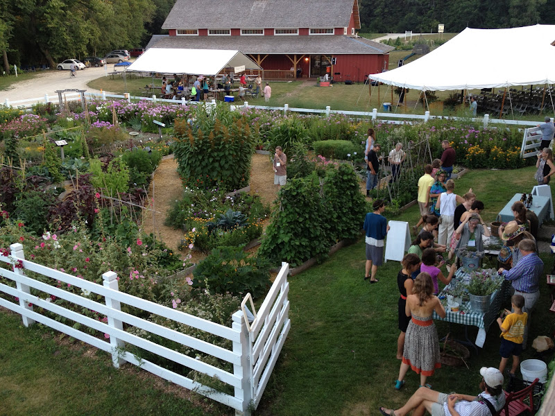 Photo: Early arrivals to the conference enjoy some social time in Diane's Garden