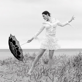 On the beach by Lee Sutton - People Portraits of Women ( woman, umbrella, white, hot, hat,  )