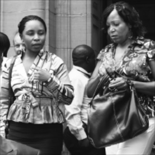 'BLACK WIDOW': Mulalo Sivhidzho, left, with her sister Humbulani Sivhidzho after her appearance at Johannesburg high court yesterday. PIC: ANTONIO MUCHAVE. 02/02/2010. © Sowetan.