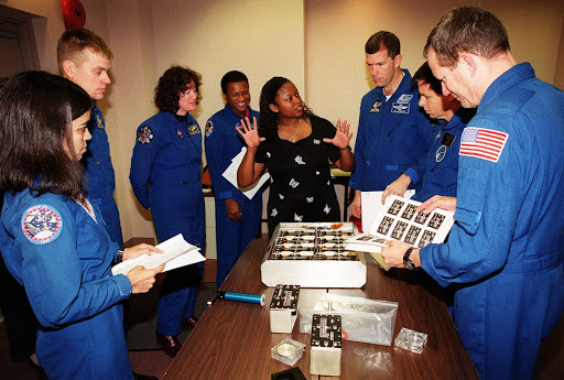 Members of the STS-107 crew learn about Biological Research in Canisters BRIC experiments that will be on their mission.