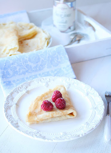 Crepes with apple and raspberries