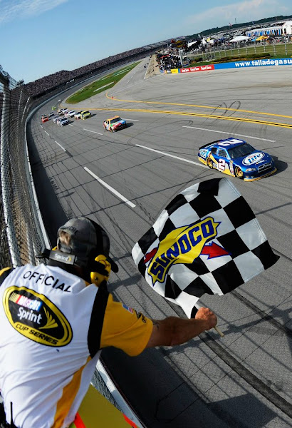 Photo: 69638047  TALLADEGA, AL - MAY 06: Brad Keselowski, driver of the #2 Miller Lite Dodge, races to the checkered flag to win the NASCAR Sprint Cup Series Aaron's 499 at Talladega Superspeedway on May 6, 2012 in Talladega, Alabama. (Photo by Jared C. Tilton/Getty Images) 2012 Getty Images