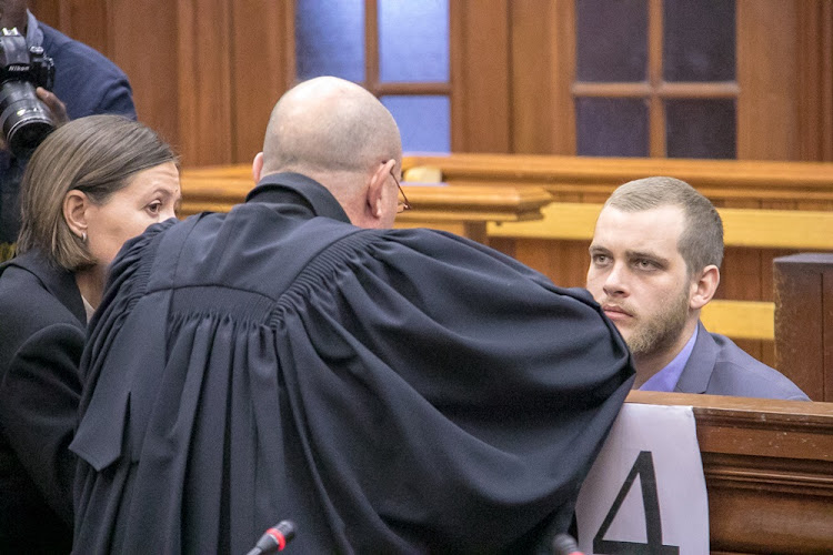 Henri van Breda talks to his legal counsel in the Cape Town High Court during his sentencing hearing on June 5 2018.