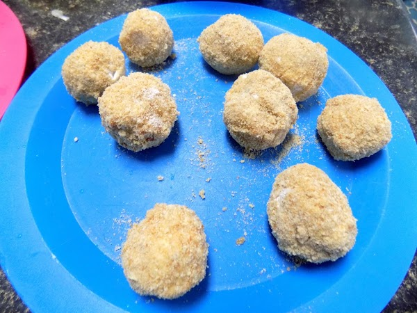 Whip egg and milk together. Dip balls into flour, then into egg mixture, then...