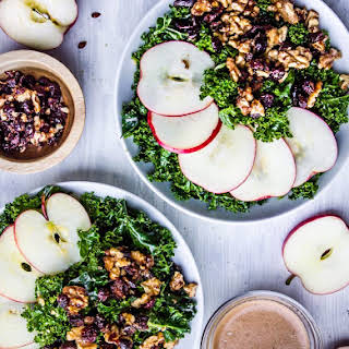 Autumn Kale Salad with Warm Apple Cinnamon Balsamic + Cranberry Walnut Clusters.