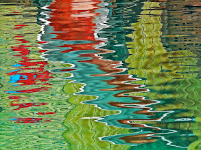 Photo: Reflections, colors, abstraction I am always fascinated by reflections, and how they can form colorful abstractions. Most of the time, they go by unnoticed, I enjoy spotting and bringing them out.