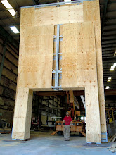 Photo: Framework for the Ford entry portal is covered in plywood as a substrate for the metal wall panels which are the exterior of the portal.