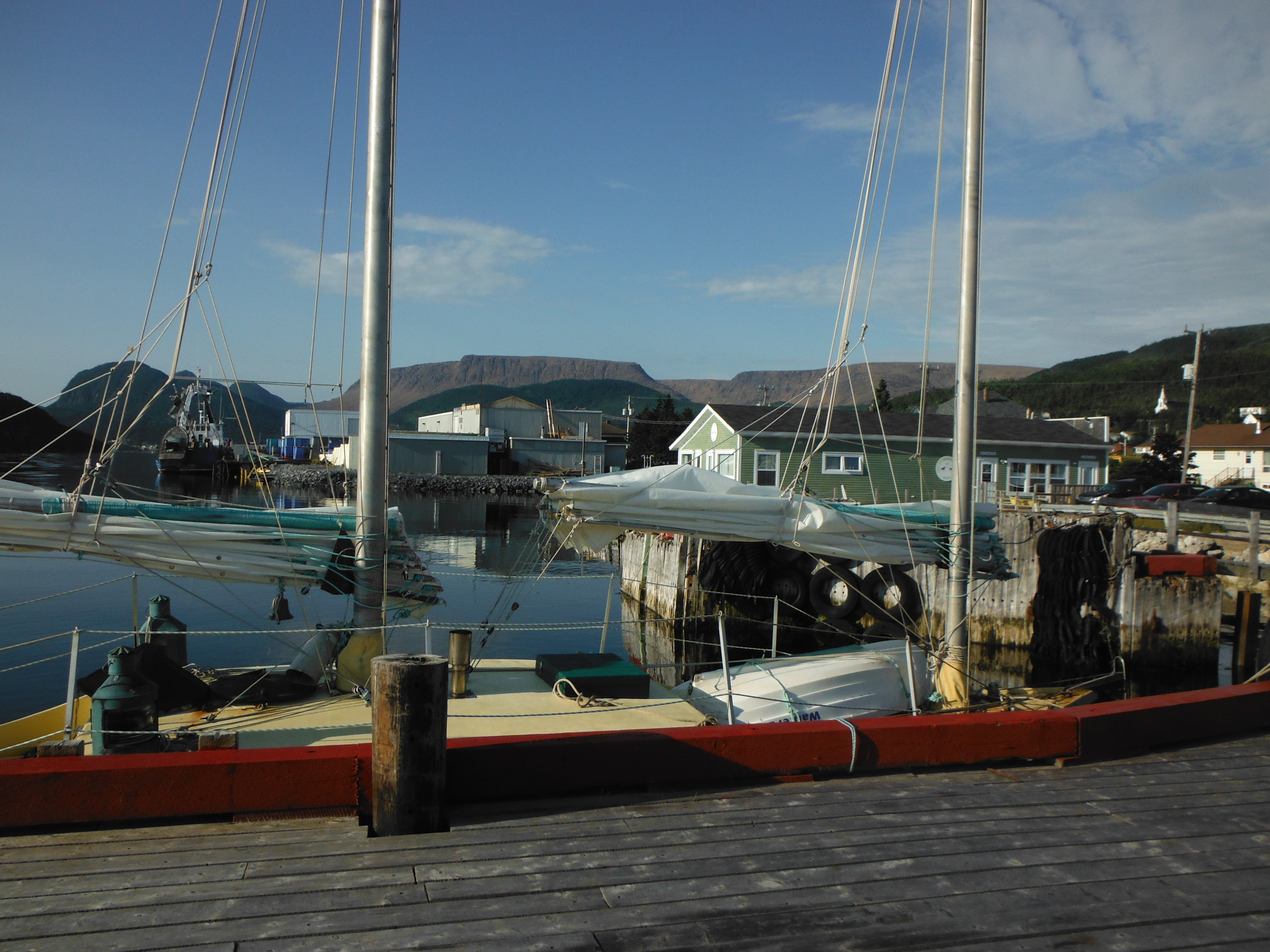 Photo: Tied to the wharf in Woody Point with the Tablelands in the distance.