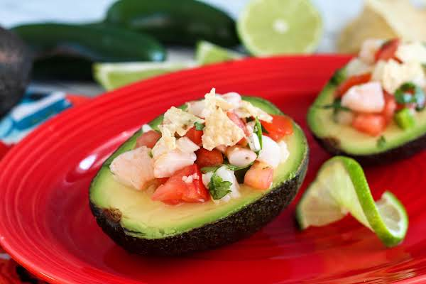 Ceviche Salad In An Avocado Half On A Plate.