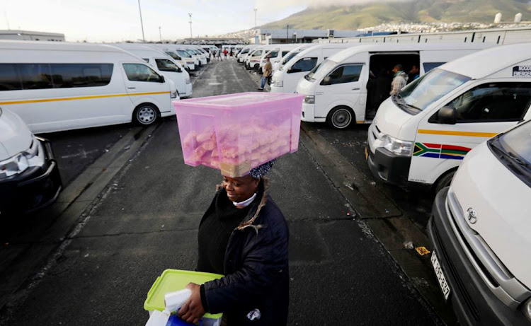 A woman selling biscuits at a Cape Town taxi rank carried on with no interruption, which was not the case for some street vendors in Gauteng, as the taxi industry there shut down on June 22 2020 after a stalemate with the government over the Covid-19 relief package.