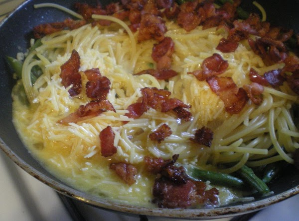 Add pasta.  Add egg and parmesean all at once. Add bacon.  Toss...