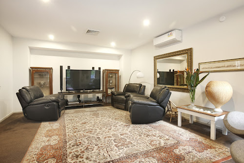 Photo of property at 12 Grevillea Avenue, Warriewood 2102