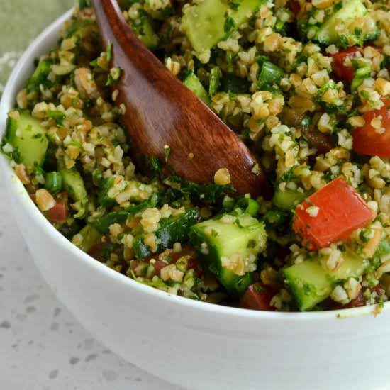 This Quick And Easy Tabbouleh Salad Is Full Of Fresh Herbs, Bulgur Wheat, Cucumbers, Tomatoes And Green Onions All Tossed With Fresh Lemon Juice And Olive Oil.  This Is One Recipe That You Can Feel Good About Feeding Your Family.